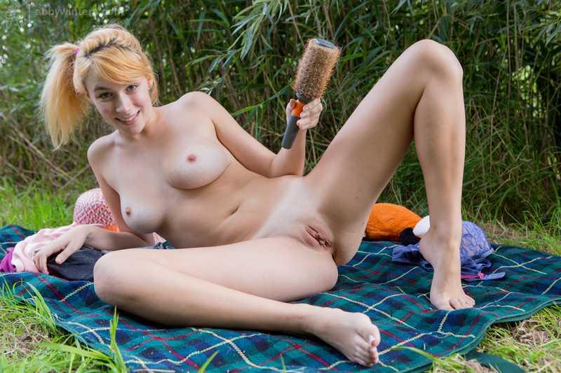 Ashley toying outdoors