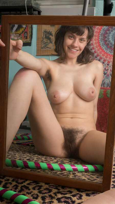 Charlee fingers her clit through her hairy bush