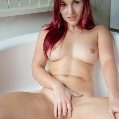 Aussie Ella peeing in the bathtub