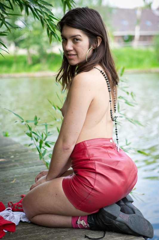 Gala fingers pussy and butt hole outdoors.