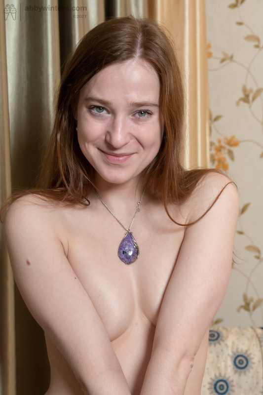 Natural redhead Lilia posing nude