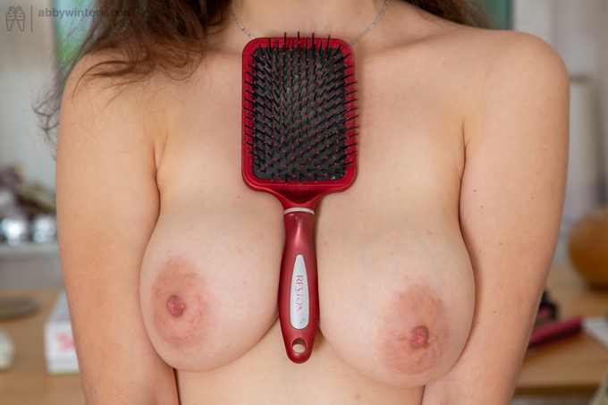 Charlee toying with her hair brush