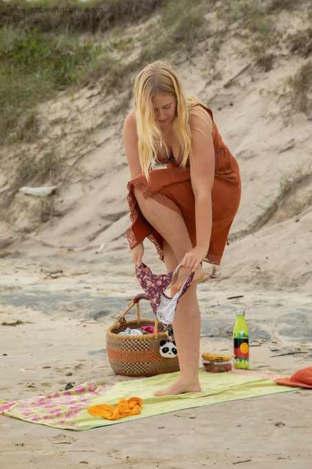 Aussie girl Juniper pissing and masturbating on the beach